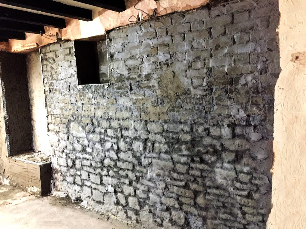 Original plaster and render courses removed before damp proofing begins by Bristol experts
