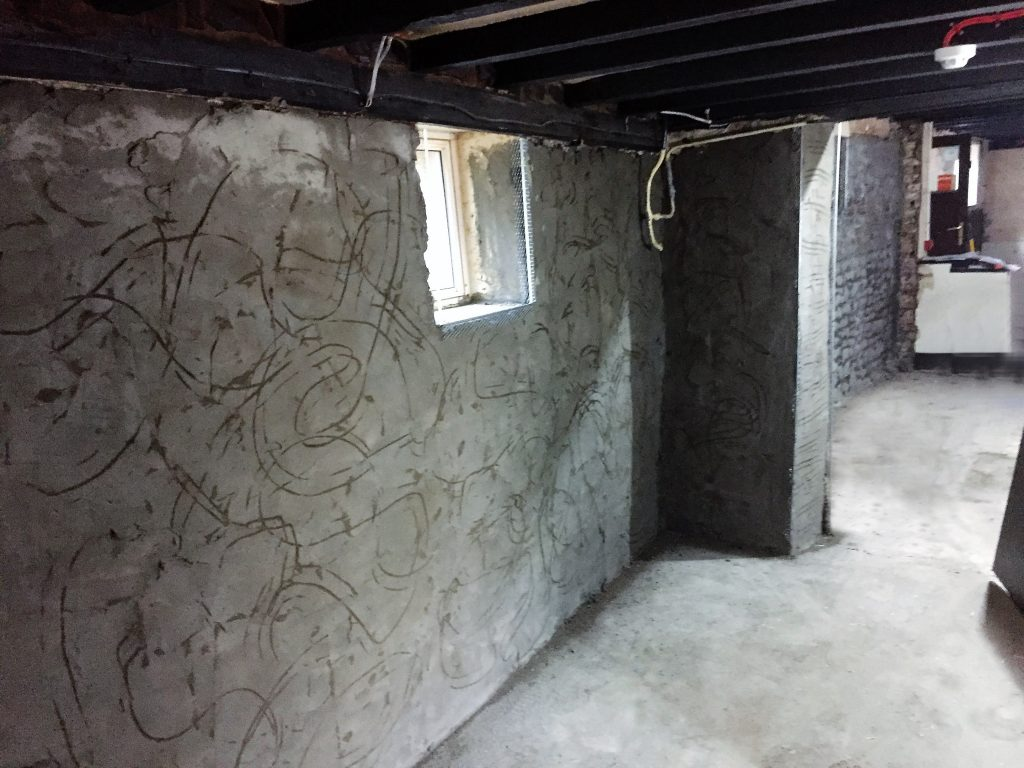 Tanking - Damp proof base coat applied to wall
